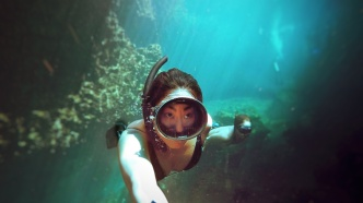 close up of freediving couple in casa cenote mexico