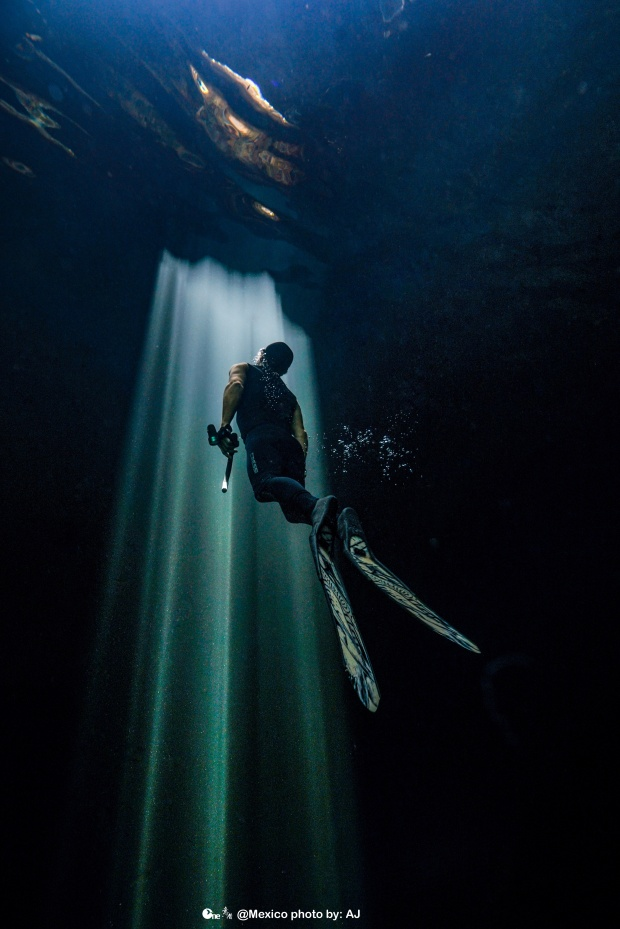 Freedive Tulum instructor cElvis James ascending into the light