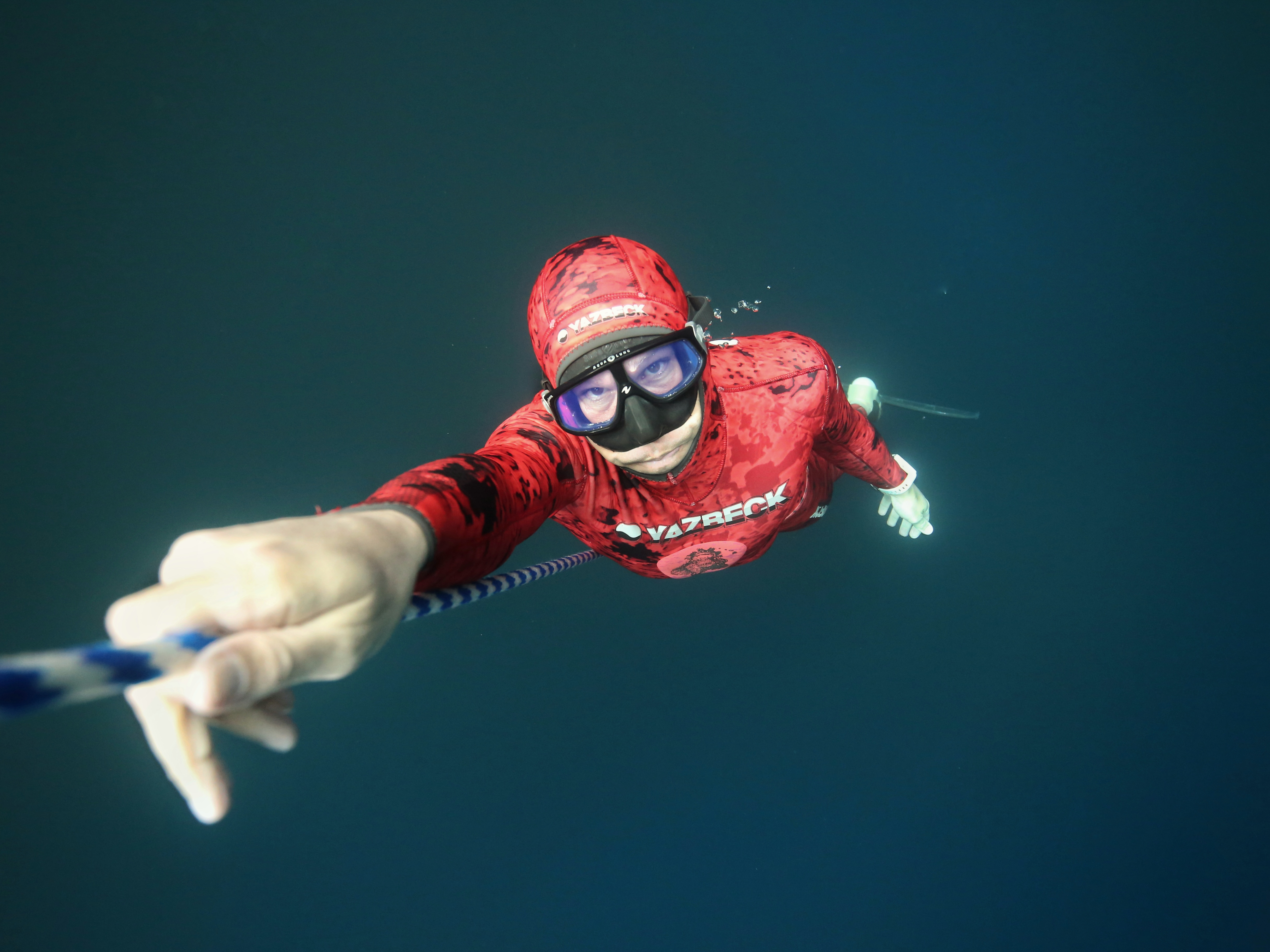 Freediver Jake ascending the line in cenote Angelita