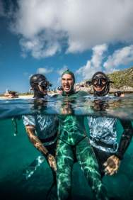 After setting a new national freediving record for Australia, Adam Stern poses with the 2 Aussie safety divers